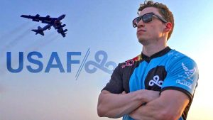 Man wearing Cloud 9 jersey in front of military jet