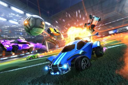 Image of two Rocket League cars racing to hit the soccer ball.