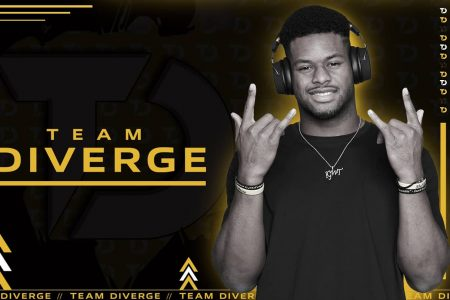 Juju Smitch-Schuster stands with a gaming headset as he announces new esports organization, Team Diverge